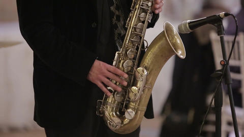 at the wedding of a man playing the saxophone Footage