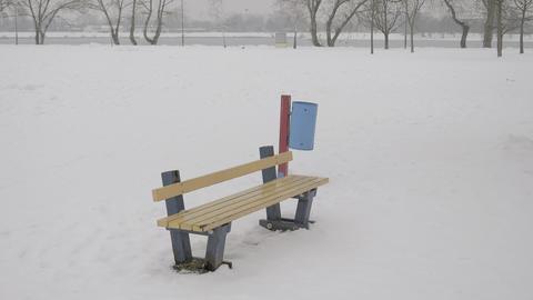 Kids playground in snow wide shot ビデオ