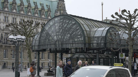 People passing on the road at City Hall of Hamburg Bus Station on a cloudy day Footage