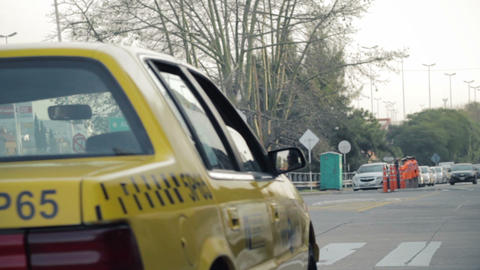 Yellow NY taxi cab getting into highway Stock Video Footage