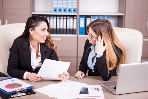Two women sitting at the office Photo