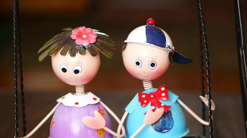 boy and girl are riding a swing interior decor toy Stock Video Footage