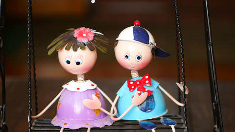 boy and girl are riding a swing interior decor toy Footage