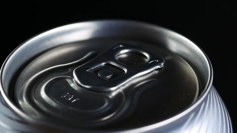 A cold drink rotates against a black background Footage