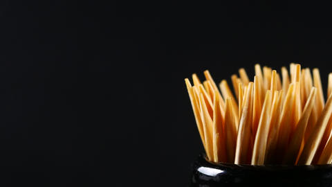 Toothpick on black background Live Action