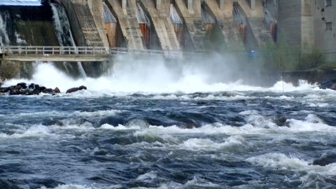 Powerful water discharge through gate of power plant Live Action