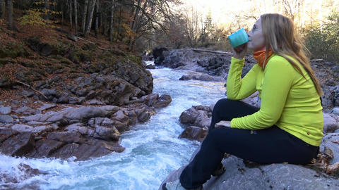 Sunny autumn day in the foothills of the Caucasus. Rest at a mountain stream Footage