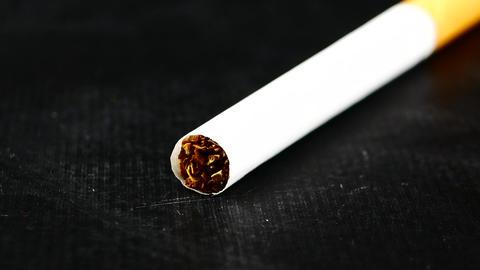 cigarette on black background Live Action