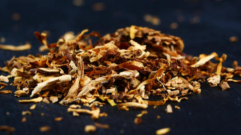 Pile of tobacco on a black background Footage