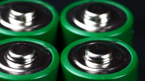Batteries in extreme close up UHD stock footage. A collection of AA batteries in Footage