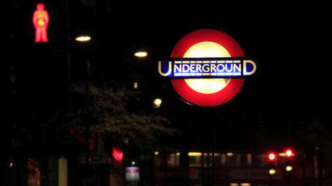 A London underground tube station sign at night time ビデオ