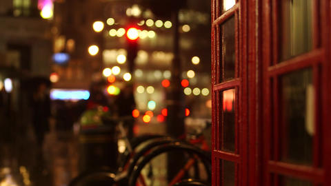 London telephone box as it rains in the background at night Footage