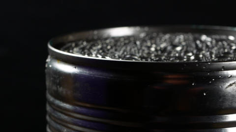 Aluminum tin can on a black background Live Action