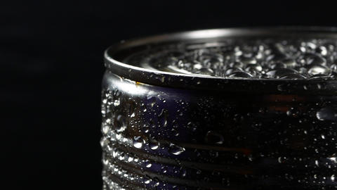 Aluminum tin can on a black background Footage