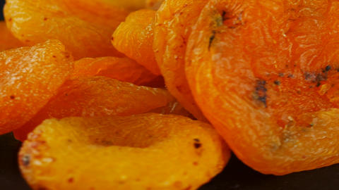 Naturally dried apricots on black background Live Action