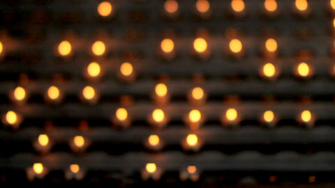 Blur church candles lights.. Small candles on table in Catholic Church Footage
