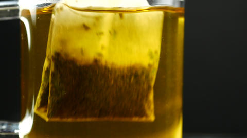 Tea bag in the cup with hot water Footage