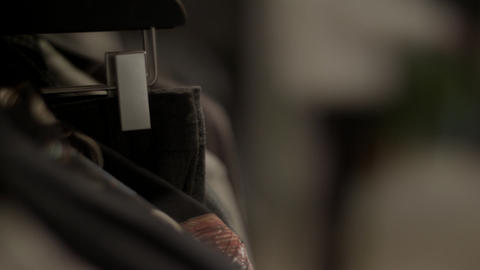 Closeup of clothing rack in retail store Footage