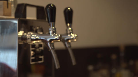 A pull focus shot on a beer tap in a pub Live Action