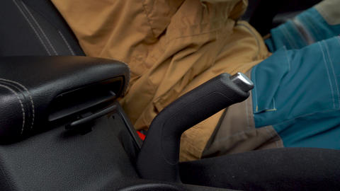 Male hand fastening car safety seat belt while sitting inside of vehicle before Footage