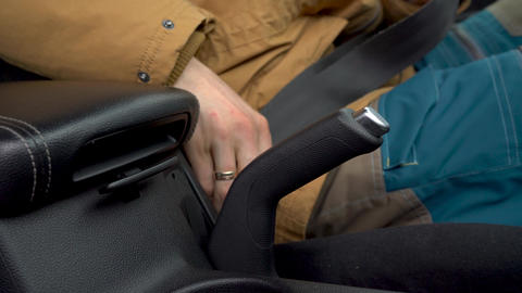 Male hand fastening car safety seat belt while sitting... Stock Video Footage