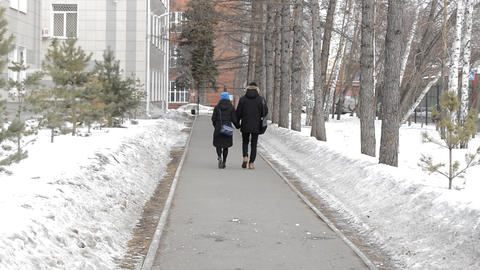 Romantic couple of students going to spring Park holding hands shooting in back Footage
