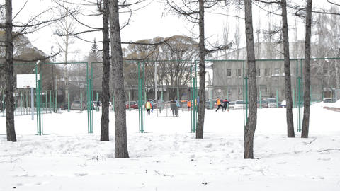 Men's team of football players trains on a snowy winter field Footage