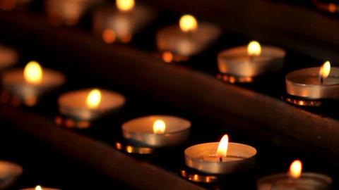 Many small church candles burn at the altar 영상물