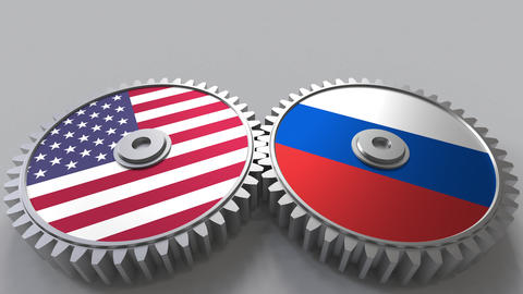 Flags of the USA and Russia on meshing gears. International cooperation Footage