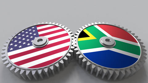 Flags of the USA and South Africa on meshing gears. International cooperation Footage