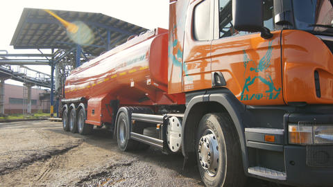 Orange Truck Transports Reservoir Filled with Oil Live Action