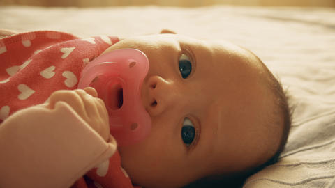 Newborn baby girl with pink pacifier Footage