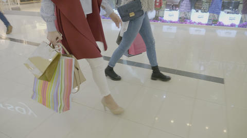 Close up of young fashion addict girls wearing heels marching in the mall to do Footage