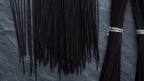 Dry black rice vermicelli on a gray stone. Asian cuisine. Video Archivo