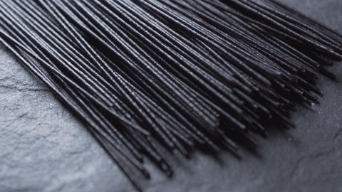 Dry black rice vermicelli on the stone free space. Asian cuisine. Video Footage