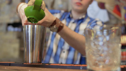 Barman squeeze fresh lemon juice for exotic cocktail Live Action