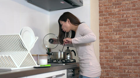 Food Burning On Stove And Woman Running In Home Kitchen Image