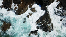 Aerial View Of Dramatic Ocean Waves Crushing On Rocks in Slow Motion GIF