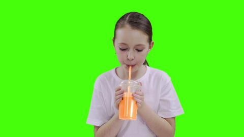 Nice girl drinking through a straw drink. Green screen Footage