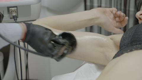 Closeup of young woman arm having skin revitalizing and tightening treatment Footage