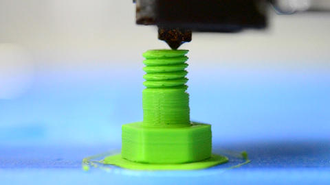 3D printer prints from the plastic figure in the form bolt Footage
