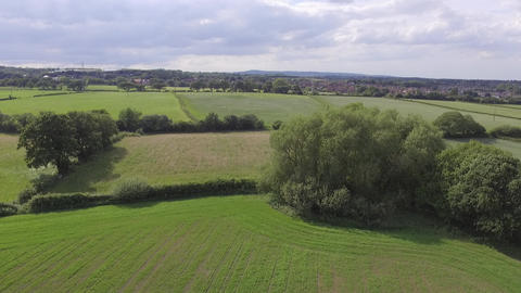 Flying Over Welsh Farm Land and Trees Near Hawarden North Wales Footage