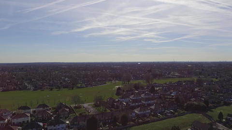 Steady Aerial Shot Looking Over Manchester Urban Area and Field Footage