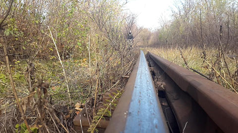 cyclist rides along the railway track Footage