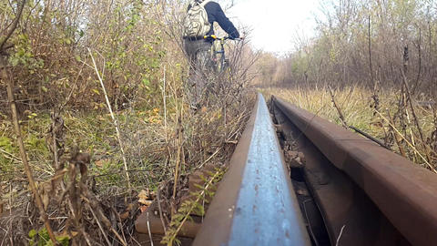 Young Man Going On The railroad Near His Bicycle Footage