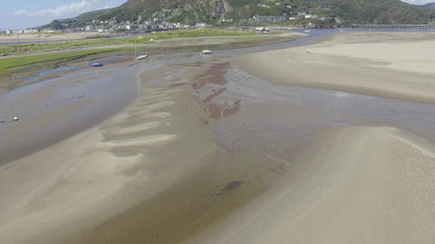 A Relatively Low Aerial Shot Flying Down Fairbourne Estuary Live Action