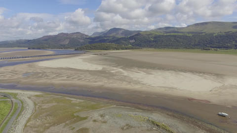 Flying Into Fairbourne Estuary Welsh Hills in the Background Live Action