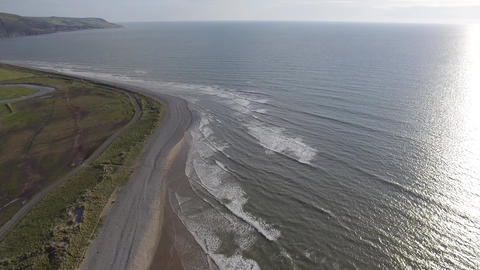 A High Aerial Shot Looking Down on the Sea and Stony Beach Footage
