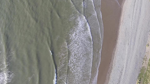 A Downward Static Aerial Shot of Waves at Fairbourne Beach Footage