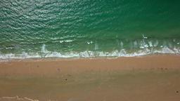 Blue water washing sand Archivo